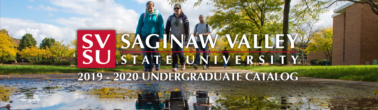 Saginaw Valley State University students walking in autumn